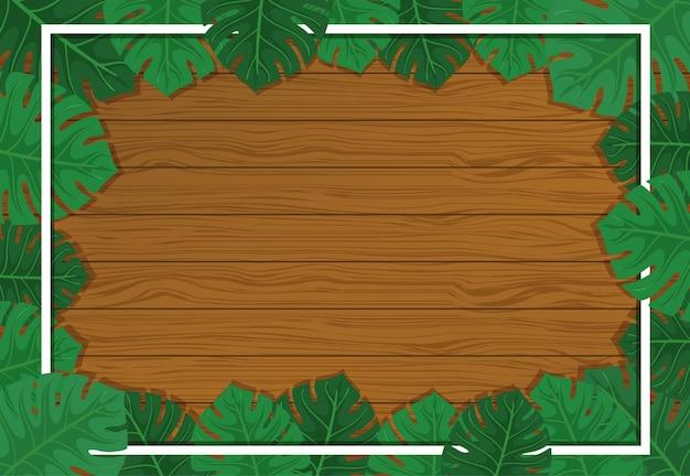 Fond en bois vide avec des éléments de feuilles de monstera