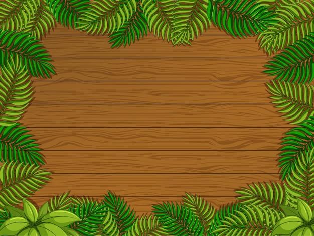 Fond en bois vide avec des éléments de feuilles tropicales