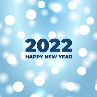 Fond de bokeh de bonne année avec des lumières blanches éclatantes défocalisées festives