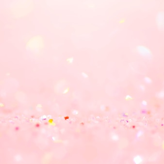Fond de bokeh de confettis rose tendre