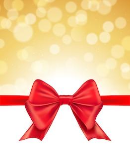 Fond de bokeh défocalisé de noël avec arc rouge. carte-cadeau invitation de célébration de vacances noël.