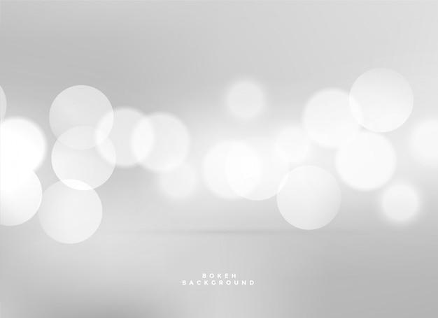 Fond de bokeh de lumières blanches élégantes