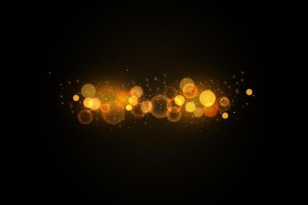 Fond de bokeh avec des paillettes.effet de lumière.particules lumineuses.