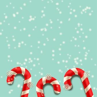 Fond de chute de neige avec canne en bonbon