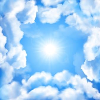 Fond de ciel bleu avec des nuages blancs et du soleil.