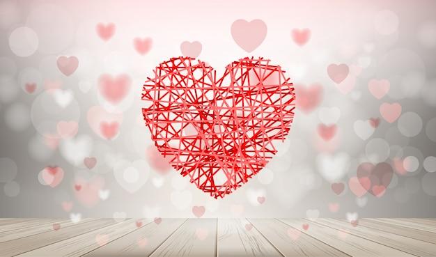 Fond de coeur rouge avec une lumière floue bokeh.