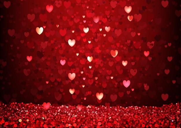 Fond de coeurs rouges scintillants