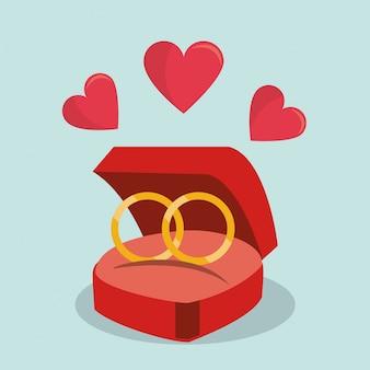 Fond coloré de bagues de fiançailles avec des coeurs