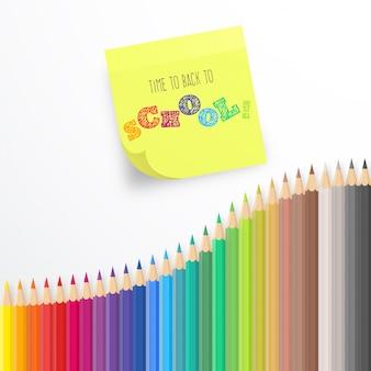 Fond coloré avec des crayons et note