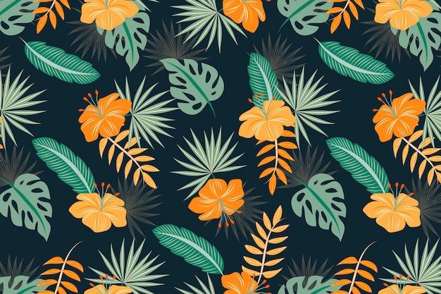 Fond coloré avec des feuilles tropicales