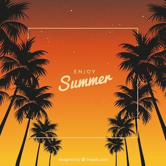 Fond de coucher de soleil avec des silhouettes de palmiers