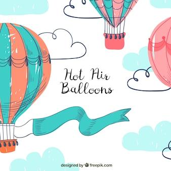 Fond de ballons à air chaud avec un ciel dans le style dessiné à la main