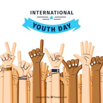 Fond de jour de la jeunesse avec les mains