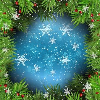 Fond de Noël avec des branches de sapin sur les flocons de neige