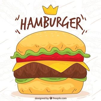 Fond décoratif d'un hamburger à la main