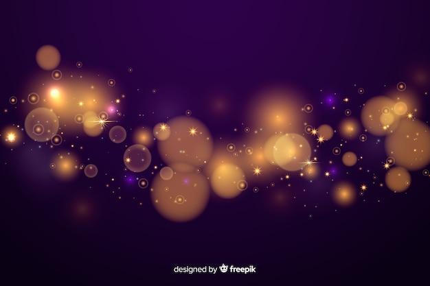 Fond décoratif de particules doré bokeh