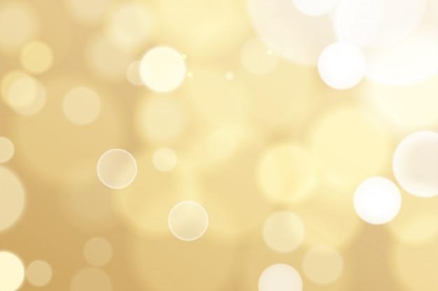 Fond décoratif de particules d'or bokeh