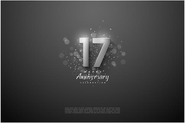 Fond du 17ème anniversaire avec illustration de chiffres argentés et effet bokeh.