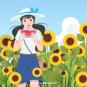 Fond de l'été avec une fille dans le champ de tournesols