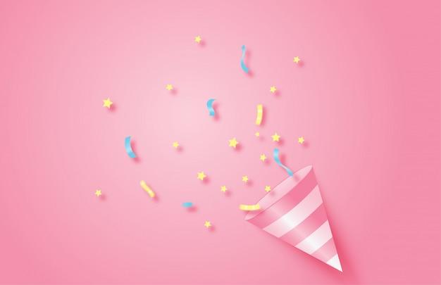 Fond de fête d'anniversaire. cône de popper rose explosif avec des confettis.