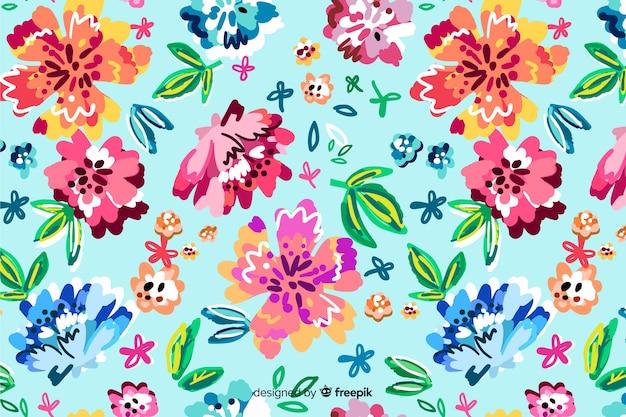 Fond avec des fleurs peintes colorées