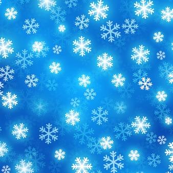 Fond flou bleu avec des flocons de neige rougeoyants