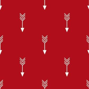 Fond géométrique sans couture lumineux avec des flèches croisées répétitives sur fond rouge pour chri...
