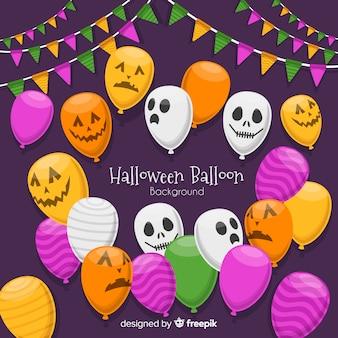 Fond d'halloween avec des ballons effrayants