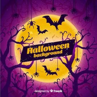 Fond de halloween heureux avec des chauves-souris, des arbres et des araignées