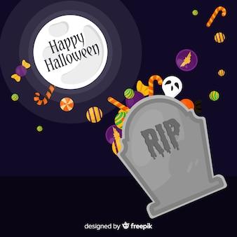 Fond de halloween heureux avec pierre tombale et bonbons