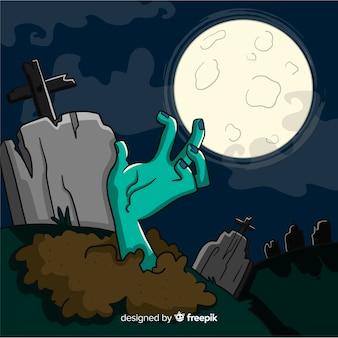 Fond d'halloween avec la main sortant de la terre