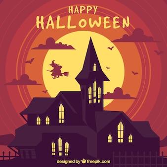 Fond d'halloween avec manoir et sorcière
