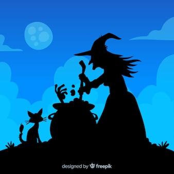Fond d'halloween avec la silhouette de la sorcière