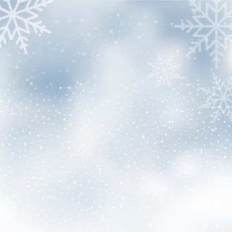 Fond d'hiver avec ciel nuageux et neigeux.