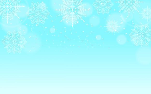 Fond d'hiver avec effet de neige et de bokeh
