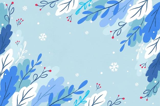 Fond d'hiver avec des feuilles dessinées et un espace vide