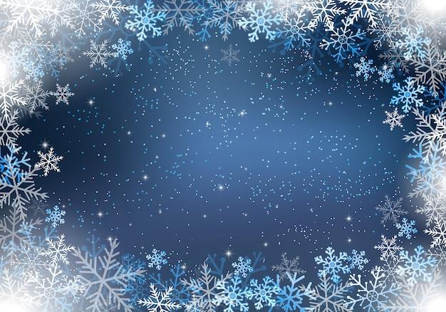 Fond d'hiver avec des flocons de neige et de la lumière