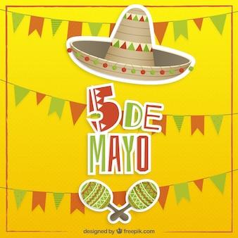Fond jaune cinq mai avec un chapeau mexicain et maraca