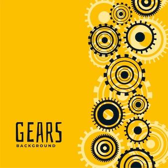 Fond jaune avec engrenages et roues dentées