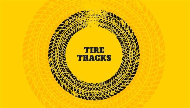 Fond jaune avec texture d'impression de piste de pneu