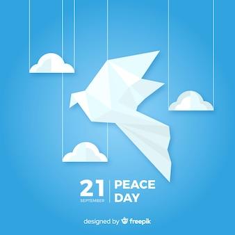 Fond de jour de paix avec la colombe d'origami