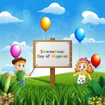 Fond de la journée internationale du bonheur avec la peinture des enfants