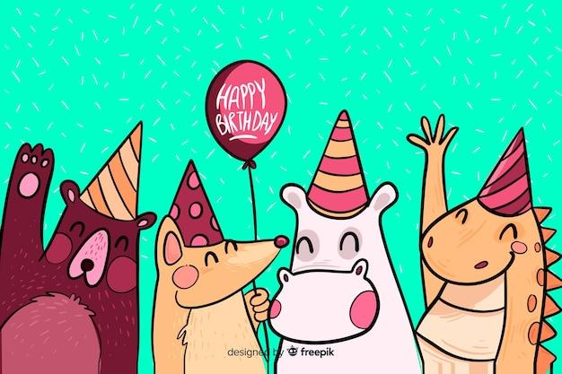 Fond de joyeux anniversaire dessiné avec des animaux à la main