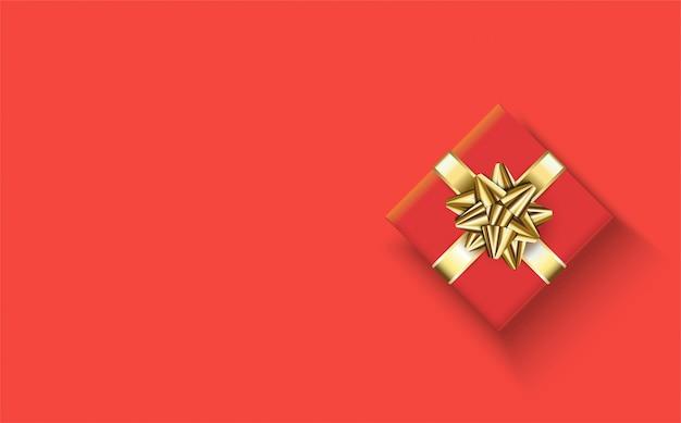Fond de joyeux anniversaire avec une illustration d'une boîte cadeau rouge et un ruban de couleur or sur rouge