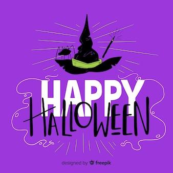 Fond de lettrage halloween heureux avec chapeau de sorcière