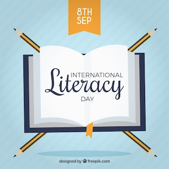 Fond de livre avec des crayons pour la journée de l'alphabétisation