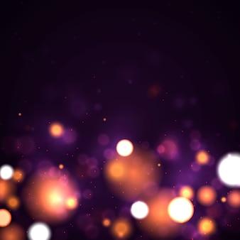 Fond lumineux violet et or festif avec bokeh de lumières colorées.