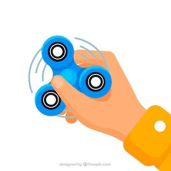 Fond de la main avec un spinner bleu