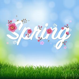 Fond de nature avec bordure d'herbe et texte de printemps