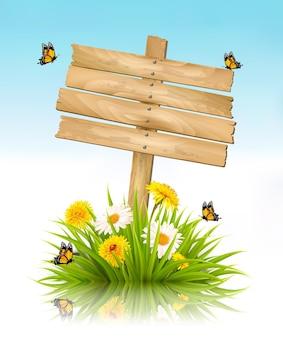 Fond de nature d'été avec de l'herbe, des fleurs et un panneau en bois. vecteur.